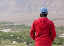 Asian traveler enjoying mountain view Stock Image