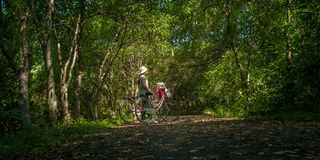 Asian traveler holiday relax with bicycle in nature park. Asian traveler holiday relax with bicycle in Bang Krachao nature park Stock Images