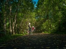 Asian traveler holiday relax with bicycle in nature park Royalty Free Stock Photography