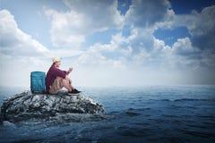 Asian traveler man alone at the small island Stock Photo