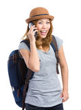 Asian traveler talk on phone Stock Photo