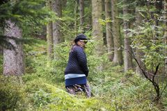 Asian traveler thai old woman walking in the forest at black forest. Or Schwarzwald at Baden-wurttemberg of Stuttgart, Germany Royalty Free Stock Image