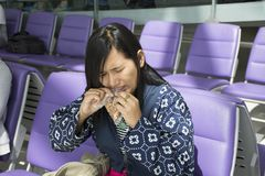 Asian traveler thai women use mouth tear off snack bag. Asian traveler thai woman use mouth tear off snack bag for eat between waiting flight at airport in Royalty Free Stock Photography