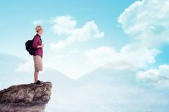 Asian traveler wearing hat on the top of the mountain Stock Photo