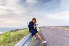 Asian traveler woman in jean dress relaxing holiday stock photography