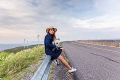 Asian traveler woman in jean dress relaxing holiday stock photo