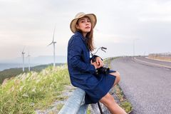 Asian traveler woman in jean dress relaxing holiday stock image