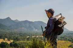 Asian travelers exploring the mountains in Chumphon, Thailand. Stock Photos