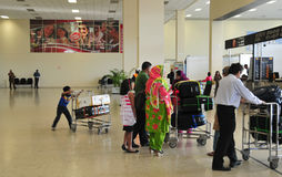 Asian travellers at arrival terminal in Tan Son Nhat. COLOMBO, SRI LANKA - AUG 29, 2014 - Asian travellers at arrival terminal in Colombo International Airport Royalty Free Stock Image