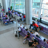 Asian travellers at arrival terminal in Tan Son Nhat Stock Image