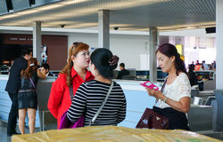 Asian travellers at arrival terminal in Tan Son Nhat Stock Photos