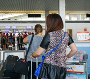 Asian travellers at arrival terminal in Tan Son Nhat. HO CHI MINH CITY, VIETNAM - JUL 2, 2015. Asian travellers at arrival terminal in Tan Son Nhat International Stock Photography