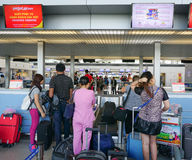 Asian travellers at arrival terminal in Tan Son Nhat. HO CHI MINH CITY, VIETNAM - JUL 2, 2015. Asian travellers at arrival terminal in Tan Son Nhat International Stock Image