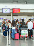 Asian travellers at arrival terminal in Tan Son Nhat. HO CHI MINH CITY, VIETNAM - JUL 2, 2015. Asian travellers at arrival terminal in Tan Son Nhat International Royalty Free Stock Photography