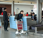 Asian travellers at arrival terminal in Tan Son Nhat Stock Photography