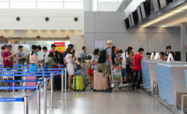 Asian travellers at arrival terminal in Tan Son Nhat. HO CHI MINH CITY, VIETNAM - JUL 2, 2015. Asian travellers at arrival terminal in Tan Son Nhat International Royalty Free Stock Images