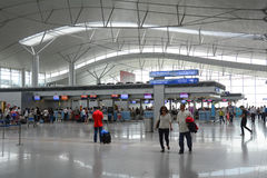 Asian travellers at departure terminal in airport Stock Image