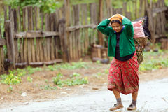 Asian tribe woman carrying food Stock Photo