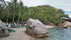 Asian tropical beach paradise in Thailand. Beaches of Thailand. Empty morning Koh Tao beach with rocks on foreground stock footage