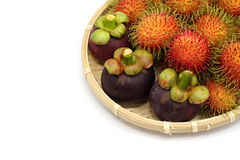 Asian tropical fruits. Rambutan and mangosteen isolated in whitebackground Royalty Free Stock Images