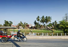 Asian tuk tuk taxi by riverside of siem reap cambodia Royalty Free Stock Images