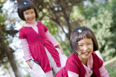 Asian twin girls playing Royalty Free Stock Photo