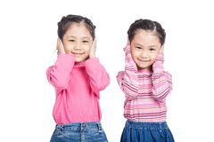 Asian twin sisters close their ears Stock Photos