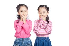 Asian twin sisters close their mouth Stock Photography