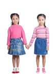 Asian twin sisters holding hands Stock Photography