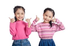 Asian twin sisters show thumbs up Royalty Free Stock Photography