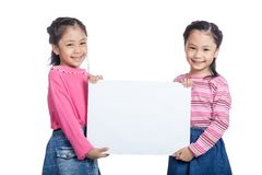 Asian twin sisters very happy hold a blank sign Royalty Free Stock Photography