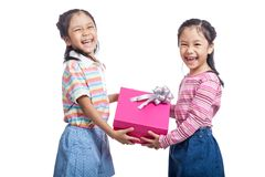 Asian twin sisters very happy hold a gift box Royalty Free Stock Photography