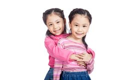 Asian twin sisters very happy look at camera. Isolated on white background Royalty Free Stock Photos