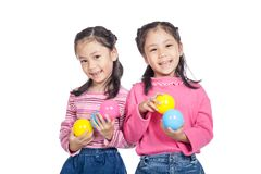 Asian twin sisters very happy playing colorful  balls Royalty Free Stock Photography