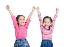 Asian twin sisters very happy  rise hands up. Isolated on white background Royalty Free Stock Photos