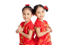 Asian twins girls in  chinese cheongsam dress with gesture of co Stock Photo