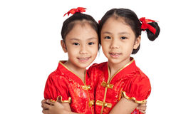 Asian twins girls in  chinese cheongsam dress Stock Images