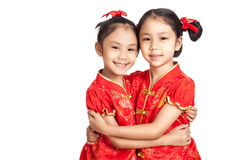 Asian twins girls in  chinese cheongsam dress Royalty Free Stock Photography
