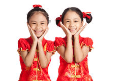 Asian twins girls in  chinese cheongsam dress Royalty Free Stock Photo
