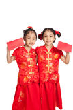 Asian twins girls in  chinese cheongsam dress with red envelopes Stock Image