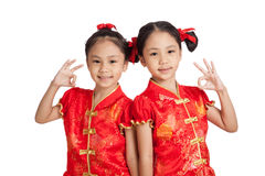 Asian twins girls in  chinese cheongsam dress show OK sign Stock Image