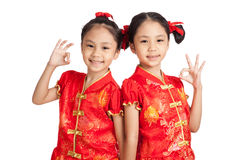 Asian twins girls in  chinese cheongsam dress show OK sign Stock Images