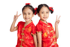 Asian twins girls in  chinese cheongsam dress  show victory sign Royalty Free Stock Images