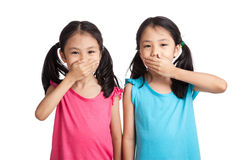 Asian twins girls shut  their mouth Stock Image