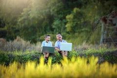 Asian Two students using joyful laptop stock photos