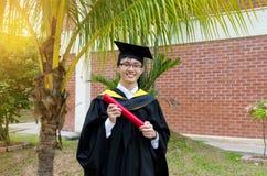 Asian university graduate. A cheerful asian university graduate Royalty Free Stock Photo