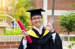 Asian university graduate. A Cheerful asian university graduate Stock Image
