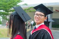 Asian university graduate. Cheerful asian university graduate looking at camera Royalty Free Stock Photography