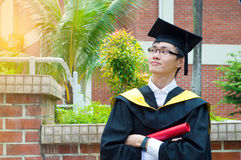 Asian university graduate. A Confident asian university graduate Stock Photo
