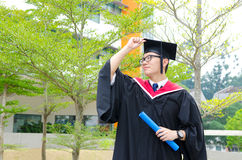 Asian university graduate. Asian university student in graduation gown and mortarboard Royalty Free Stock Photos